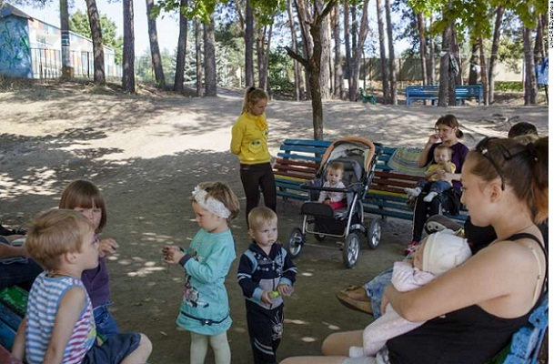 Children and their mothers in a recreation area of the Promotei Summer Camp. These people had been forced to flee their homes in eastern Ukraine.